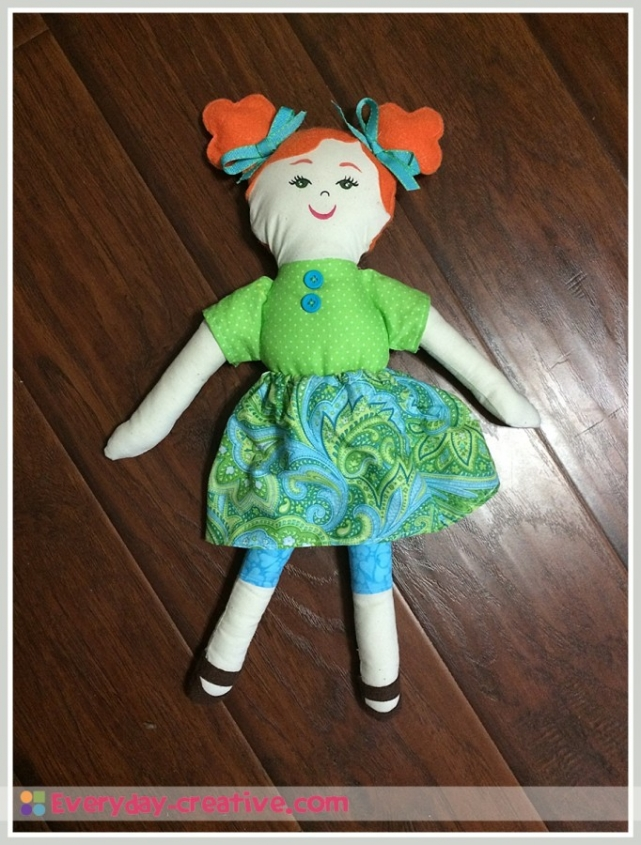 Redhead rag doll with fabric body and basic skirt